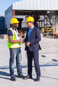 construction manager and worker handshake on site